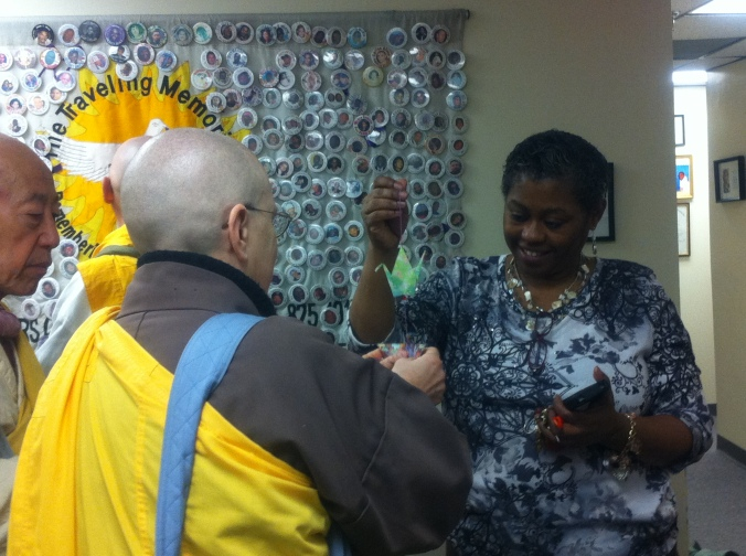Sr. Clare Carter presents Tina Cherry host and founder of the Louis D. Brown Peace Institute with Peace Cranes